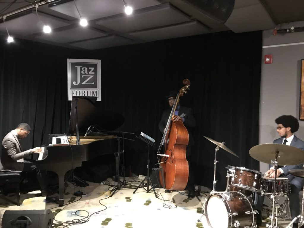 Pianist Christian Sands and his trio playing at the Jazz Forum Club
