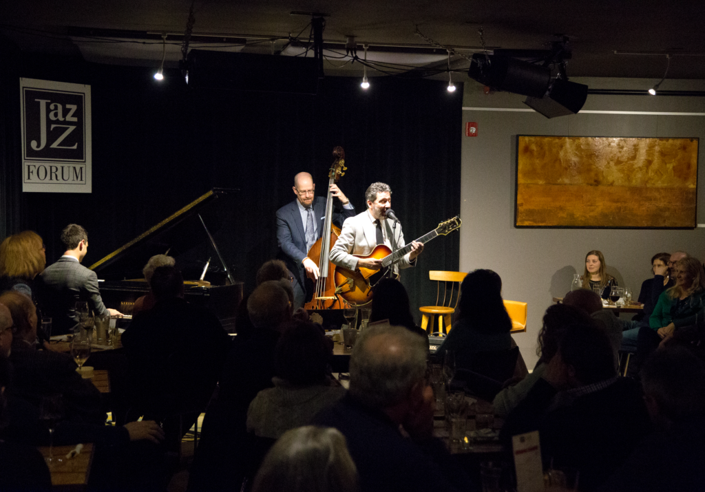 John Pizzarelli performing live for a huge audience inside the Jazz Forum Club