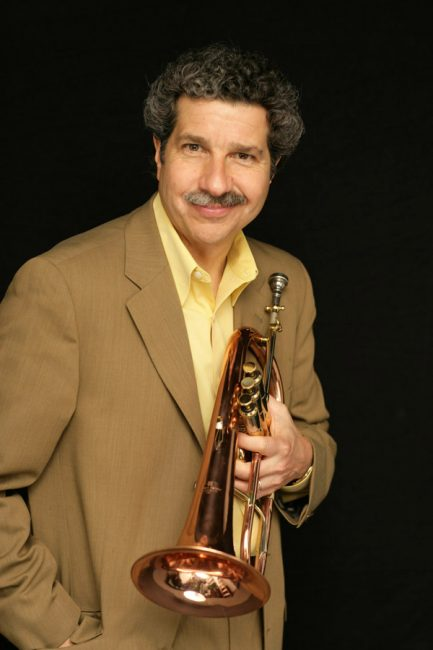 Mark Morganelli holding his flugelhorn for a portrait